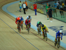 Cyclists in action during Rio 2016 Olympics women`s keirin first round heat 4 at the Rio Olympic Velodrome. RIO DE JANEIRO, BRAZIL - AUGUST 13, 2016: Cyclists in Stock Photography