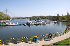 Cyclists on Ada Ciganlia lake in Belgrade Royalty Free Stock Photo
