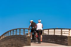 Cyclists against blue sky background, Leucate, France. Copy space for text. stock photos