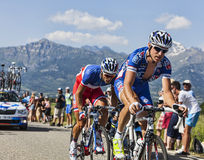 The Cyclists Alexandre Geniez and Arthur Vichot. Col de Manse, France- July 16, 2013: The French cyclists Alexandre Geniez and Arthur Vichot(FDJ.fr Team) on a Royalty Free Stock Images