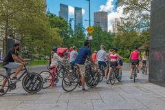 Cyclists along Central Park South. New York, NY US -- August 31, 2016.  A group of cyclists by Central Park South in New York city. Editorial Use Only Royalty Free Stock Photo
