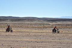 The cyclists in the Altiplano Royalty Free Stock Photo