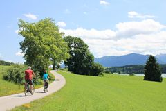 Cyclists - on a beautiful landscape Royalty Free Stock Image