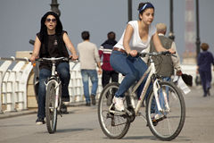 Cyclists, Beirut. Two female cyclists cycling along the seafront in Beirut, Lebanon Stock Photo