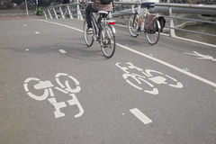 Cyclists on Bike Lane in Amsterdam, Holland Stock Photo