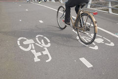 Cyclists on Bike Lane in Amsterdam, Holland Royalty Free Stock Photography