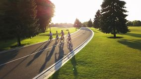 Cyclists on bikes outdoors, aerial view. stock video