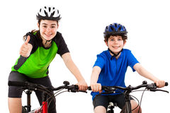 Cyclists - boy and girl isolated on white Stock Photography