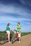 Cyclists chatting on a sunny day Royalty Free Stock Photos