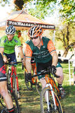 Cyclists competing in cyclocross race Stock Photo