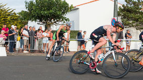 Cyclists in a curve during a road bike race. Saint Gilles Croix de Vie, France - September 10, 2016 : Final triathlon championship of France in the category D3 stock images