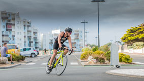 Cyclists in a curve during a road bike race. Saint Gilles Croix de Vie, France - September 10, 2016 : Final triathlon championship of France in the category D3 royalty free stock photos