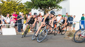Cyclists in a curve during a road bike race. Saint Gilles Croix de Vie, France - September 10, 2016 : Final triathlon championship of France in the category D3 stock photos