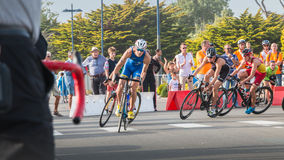 Cyclists in a curve during a road bike race. Saint Gilles Croix de Vie, France - September 10, 2016 : Final triathlon championship of France in the category D3 stock photography