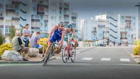 Cyclists in a curve during a road bike race. Saint Gilles Croix de Vie, France - September 10, 2016 : Final triathlon championship of France in the category D3 stock photo
