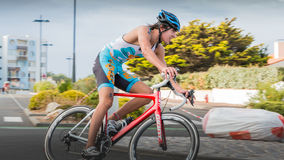 Cyclists in a curve during a road bike race. Saint Gilles Croix de Vie, France - September 10, 2016 : Final triathlon championship of France in the category D3 royalty free stock images