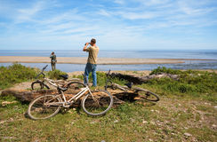 Cyclists on a deserted coast Royalty Free Stock Photography