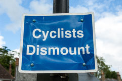 Cyclists Dismount sign Royalty Free Stock Images