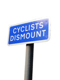 Cyclists dismount traffic sign UK. Close up of cyclist dismount blue traffic sign UK Royalty Free Stock Photo