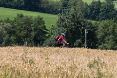 cyclists in a distance view on a summer sunny day stock photos