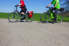 Cyclists on an electric bike on a bikeway. At springtime april afternoon with sun and blue sky autumn bicycle biker biking city country cycling danube ebike stock photos