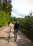 Cyclists in forest Stock Images