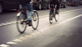 Cyclists on gloomy day Royalty Free Stock Image