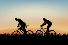 Cyclists on grass Stock Photography