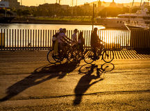 Cyclists by the harbor in Port Vell Royalty Free Stock Photo