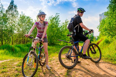 Cyclists in helmets and sunglasses resting Stock Images