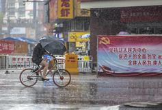 Free Cyclists In The Rain Stock Photography - 125818592