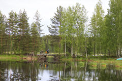 Cyclists journey around Karelia. Finland Royalty Free Stock Photos