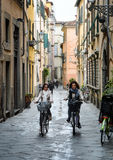 Cyclists in Lucca, Italy Stock Images