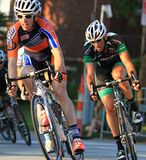 Cyclists make the turn Stock Images