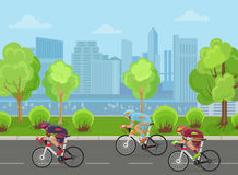 Cyclists mans on road race bicycle racing in city park concept. Stock Image