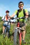 Cyclists on meadow Royalty Free Stock Photo