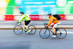 Cyclists in motion blur in the city traffic of London, UK Royalty Free Stock Photo