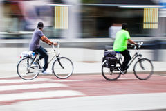 Cyclists in motion blur Royalty Free Stock Photos