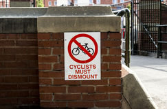 Cyclists must dismount. Warning sign to cyclists that they must get off their bikes Royalty Free Stock Photography