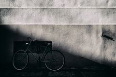 Cyclists at an old wall with a relief Stock Photo