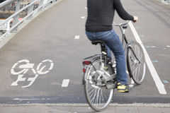 Cyclists On Bike Lane In Amsterdam, Holland Royalty Free Stock Photo