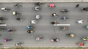Cyclists participate in race and ride along asphalt road stock video footage