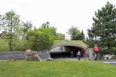 Free Cyclists Passing In A Tunnel Under The Road Stock Image - 161225911