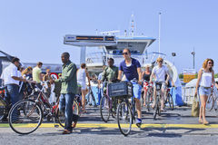 Cyclists and pedestrians on ferryboat arrival, Amsterdam. AMSTERDAM-AUG. 19, 2012. Cyclists and pedestrians on ferryboat arrival on Aug. 19, 2012 in Amsterdam Royalty Free Stock Photography