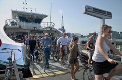 Cyclists and pedestrians on ferryboat arrival, Amsterdam.