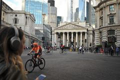 Cyclists and pedestrians in traffic in East London , England stock images