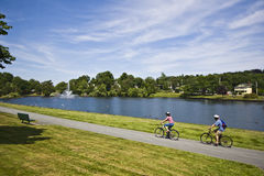 Cyclists by the pond. Cycling by Sullivan's Pond in Dartmouth Nova Scotia Royalty Free Stock Photography