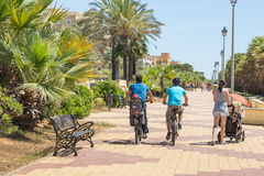 Cyclists on the promenade, Costa de Luz, Ayamonte, Spain. Royalty Free Stock Photography