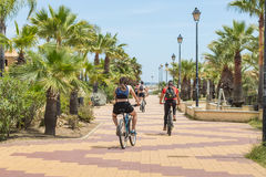 Cyclists on the promenade, Costa de Luz, Ayamonte, Spain. Royalty Free Stock Photo