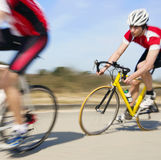 Cyclists in pursuit. Cyclist at high speed in pursuit. Motion blur panned image Royalty Free Stock Image